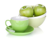 Green apples in fruit bowl and tea cup Stock Image