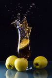 Green apples and glass with juice Stock Photos