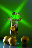 Green apples and glass with juice Royalty Free Stock Photo