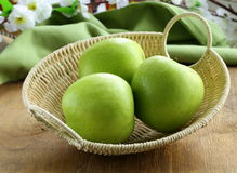 Green apples Granny Smith in a basket Royalty Free Stock Photography