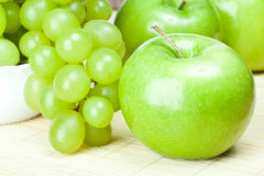 Green apples and grapes Royalty Free Stock Photos
