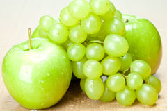 Green apples and grapes on the table Stock Photo