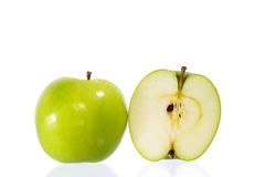 Green apples. And half of apple Isolated on a white background royalty free stock images