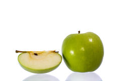Green apples and half. Of apple Isolated on a white background royalty free stock image