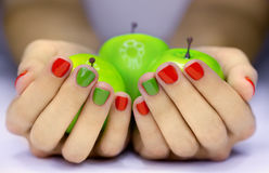 Apples in hands Royalty Free Stock Photo