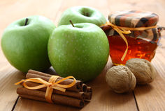 Green apples and honey. Royalty Free Stock Images