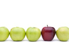 Green apples with an individual red apple Royalty Free Stock Photography