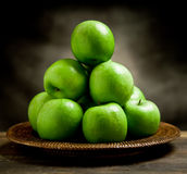Green Apples inside a basket Stock Images