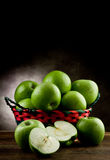 Green Apples inside a basket Stock Photography