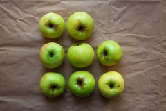 Green apples on beige paper background stock image
