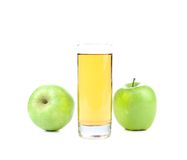 Green apples and juice in the glass Royalty Free Stock Photo