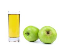 Green apples and juice on white Stock Images