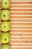 Green apples lie on  bamboo mat Stock Photos