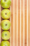 Green  apples lie on  bamboo mat Royalty Free Stock Image