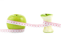 Green apples measured the meter Royalty Free Stock Images