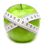 Green apples measured the meter Royalty Free Stock Photos