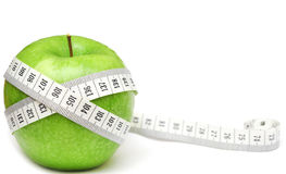 Green apples measured the meter Royalty Free Stock Image