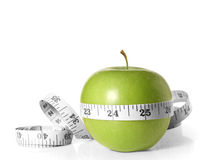 Green apples measured the meter Royalty Free Stock Photography
