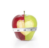 Green apples measured the meter Royalty Free Stock Photo