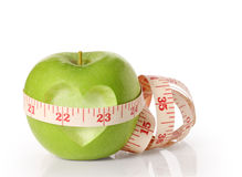 Green apples measured the meter on  white Royalty Free Stock Photo