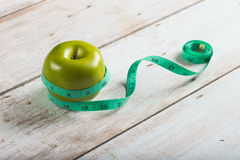 Green apples measured Royalty Free Stock Photo