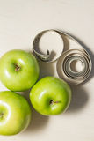 Green apples and measuring tape Royalty Free Stock Images