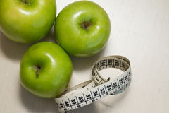 Green apples and measuring tape Stock Photography
