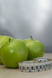 Green apples and measuring tape Stock Photo