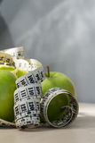 Green apples and measuring tape Royalty Free Stock Photo
