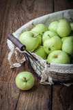 Green apples in a metal basket. Royalty Free Stock Photography