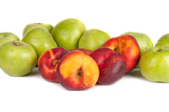Green apples and nectarines. On a white background Royalty Free Stock Images