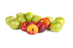 Green apples and nectarines. On a white background Stock Photos