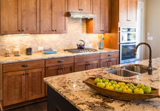 Green Apples on New Granite Countertop Stock Photo