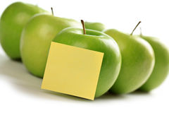 Green apples and notepaper Royalty Free Stock Images