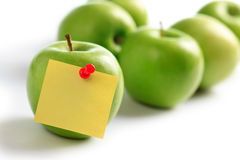 Green apples and notepaper. On white background Stock Images