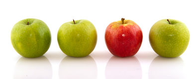 Green apples with one red one Stock Photo