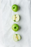 Green apples over white cloth Stock Photography