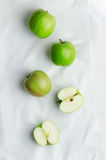 Green apples over white cloth Royalty Free Stock Photo