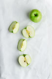 Green apples over white cloth Royalty Free Stock Photos