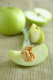 Green apples and peanut butter Stock Photo