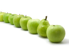 Green apples and pear. Fresh green apples and pear on white background stock images