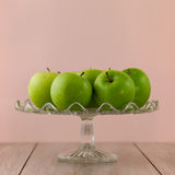 Green apples on pink Royalty Free Stock Photo