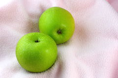 Green Apples on pink cloth Royalty Free Stock Photo