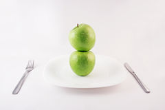 Green apples on a plate Stock Images