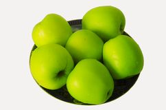 Green apples on a plate Stock Photography