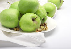 Green apples on a porcelain plate Royalty Free Stock Photos