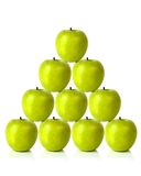 Green apples on a pyramid shape Stock Photo