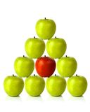 Green apples on a pyramid shape - be different Royalty Free Stock Photos