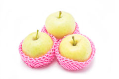 Green apples in red packaging. Royalty Free Stock Photography