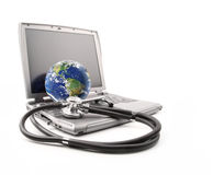 Green apples with stethoscope against white Royalty Free Stock Images
